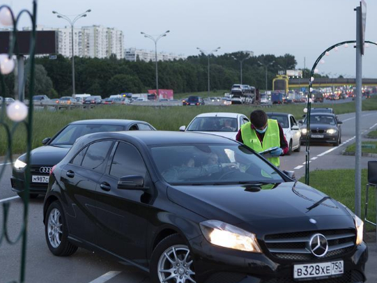 People watch movie at drive-in cinema in Moscow