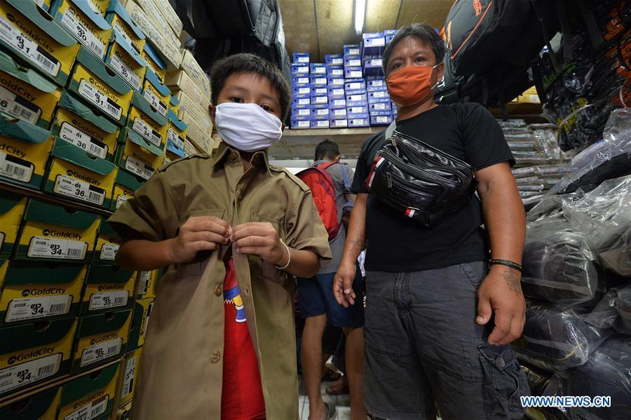 Thai students try on new school uniform at clothing store in Bangkok