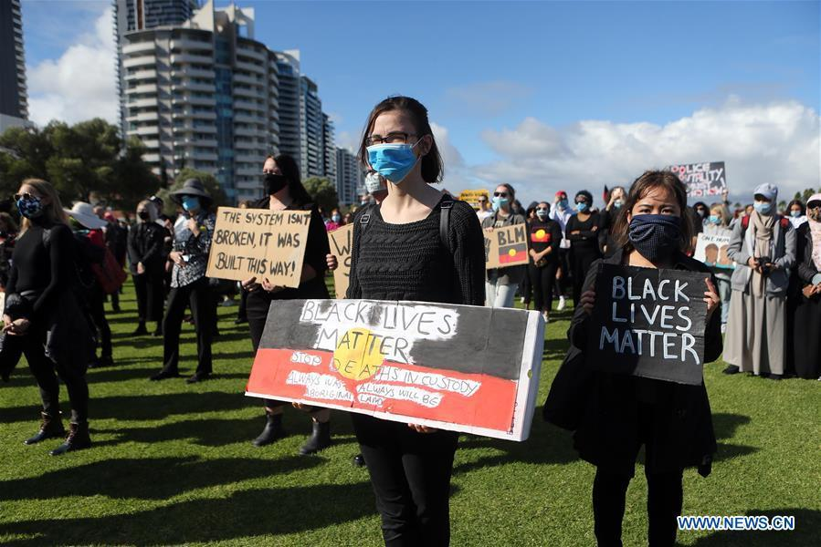 People take part in protest over death of George Floyd in Perth, Australia