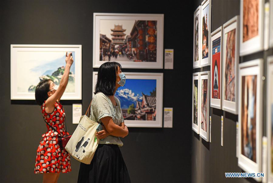 World cultural heritage photography art exhibition opens in Hainan