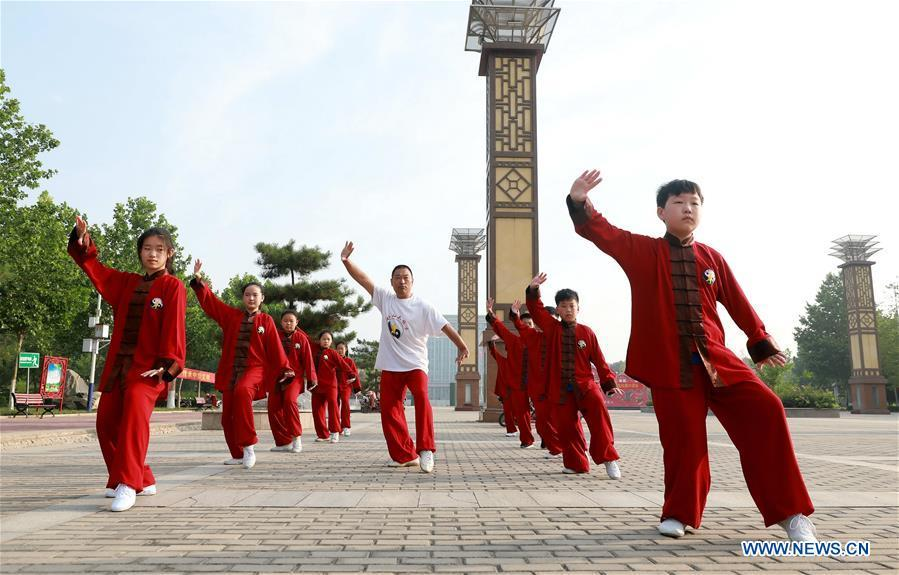 Citizens perform Taichi on China's Cultural and Natural Heritage Day in Hebei