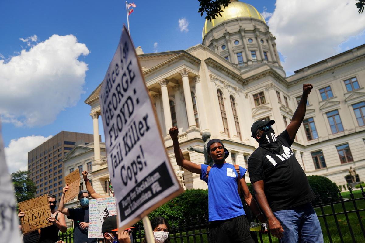 Protesters march onto Atlanta highway over deadly police shooting of African American