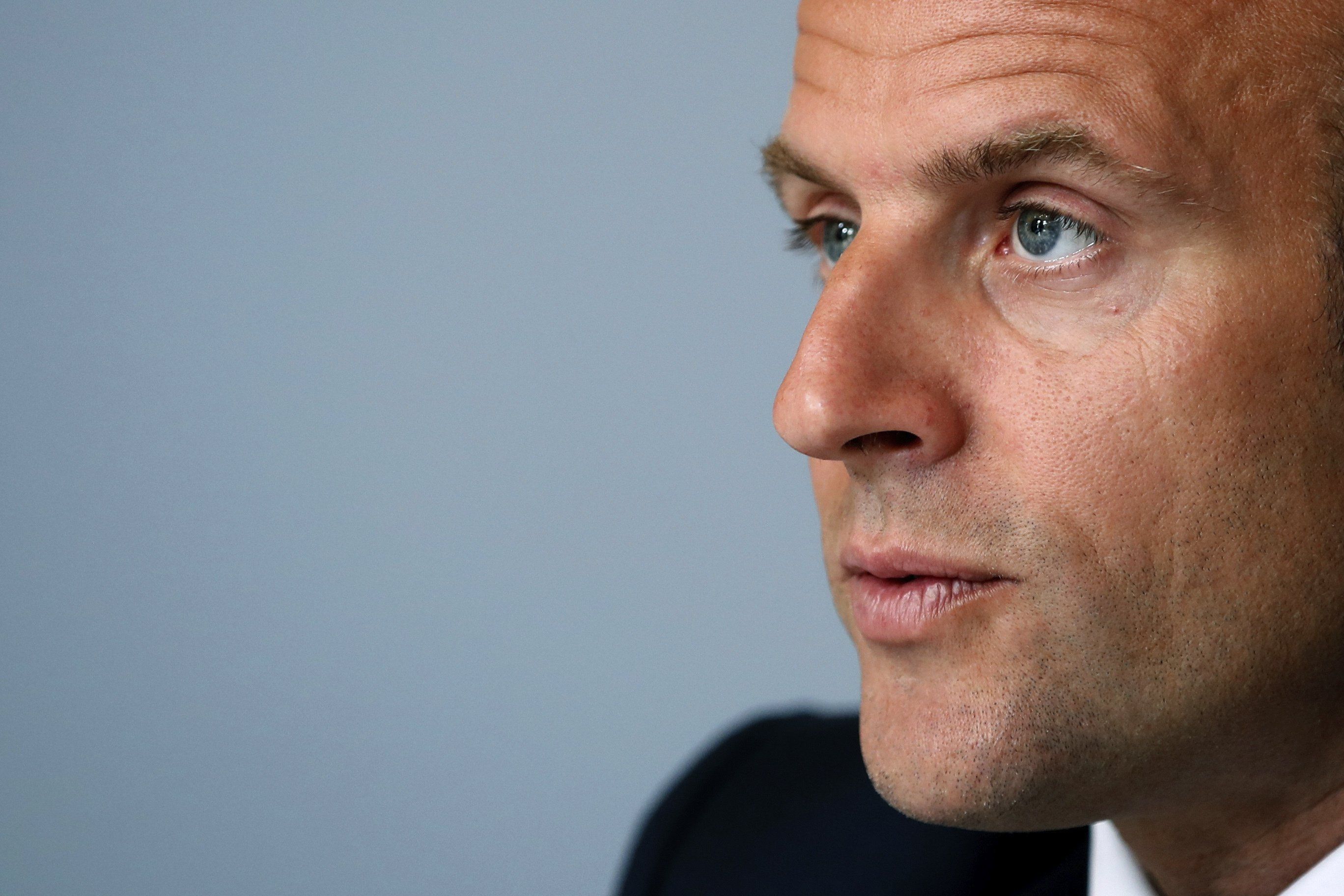 French leader rejects racism but colonial statues to remain