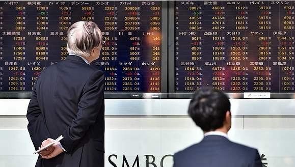 Tokyo stocks close sharply higher on Fed's corporate debt-buying program