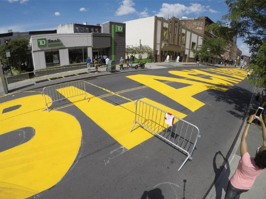 'Black Lives Matter' painted in bright yellow on street in New York