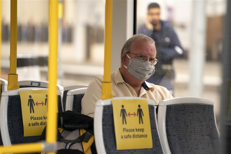 Face covering compulsory on public transport as UK further eases lockdown