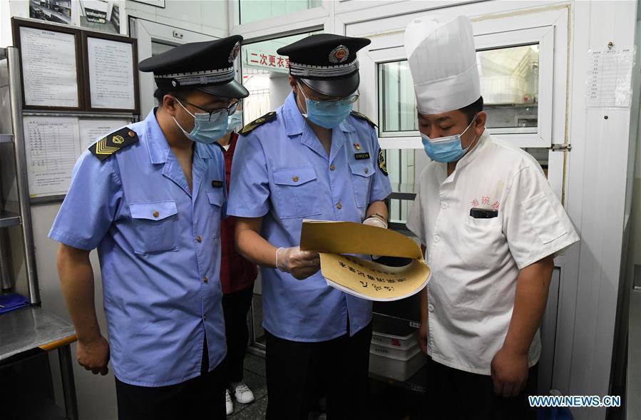 Market regulation administration staff inspect market, restaurant in Haidian District of Beijing