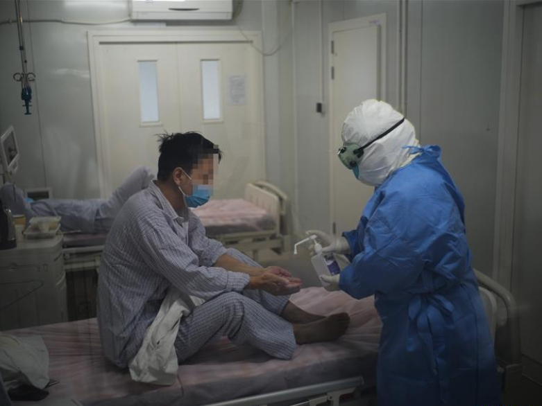 COVID-19 patients receive medical treatment in Beijing Ditan Hospital