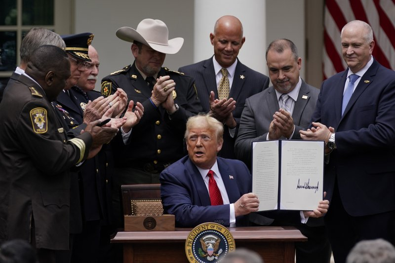 Trump signs order on police reform, doesn't mention racism