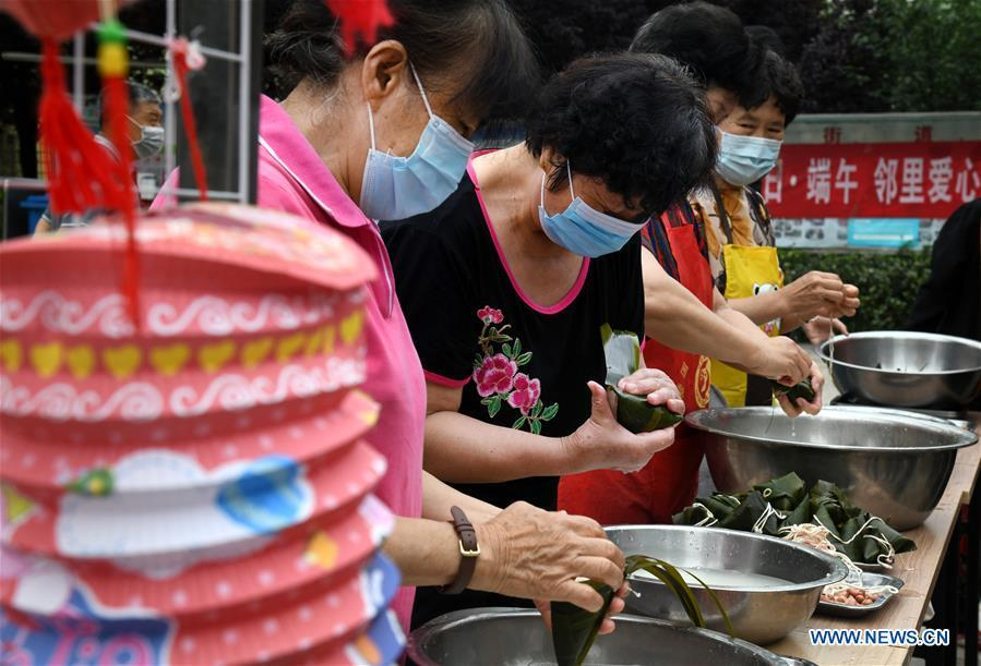 People make Zongzi at residential community in Qingdao