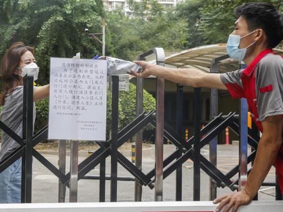 Beijing resumes closed-off community management