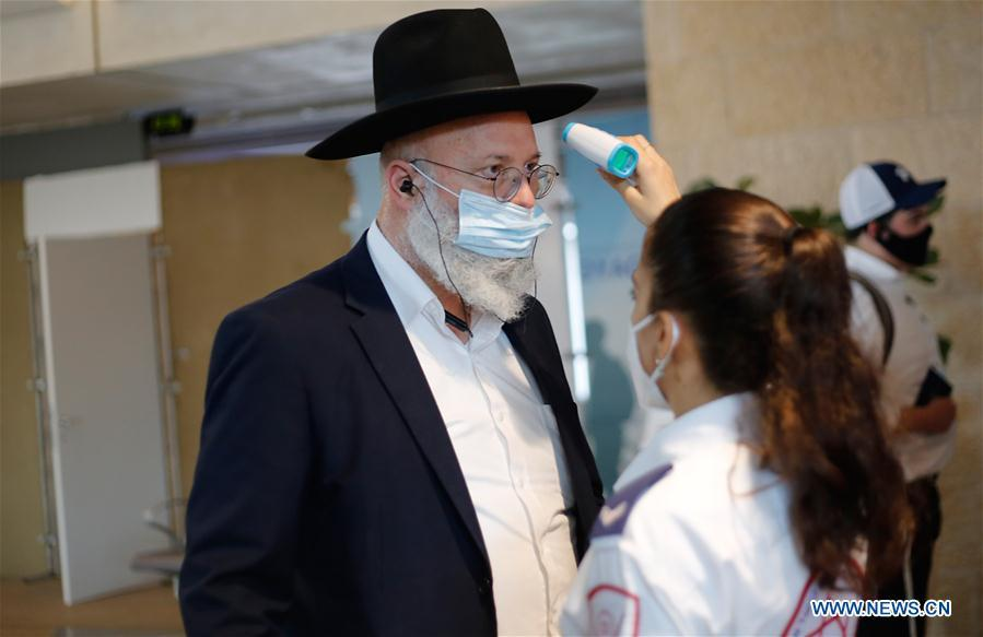 Israeli medical workers check temperature of passengers at Ben Gurion Int'l Airport