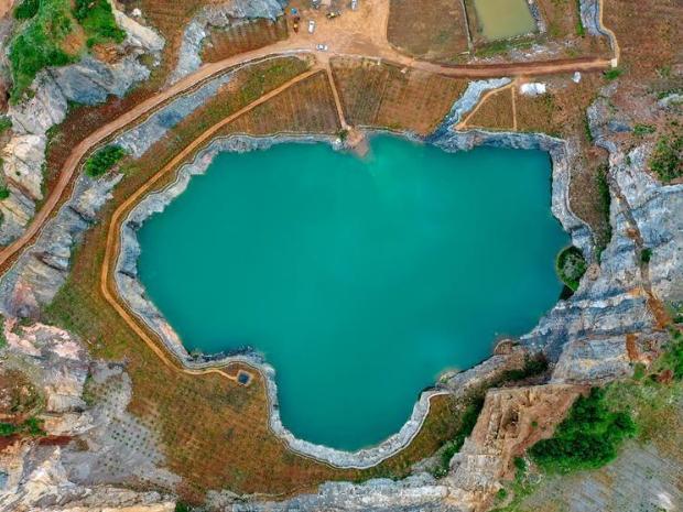 Open-pit mine becomes pond after afforestation