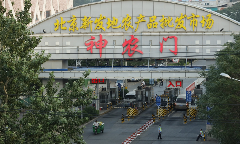 Beijing's food market COVID-19 spread 'basically controlled'