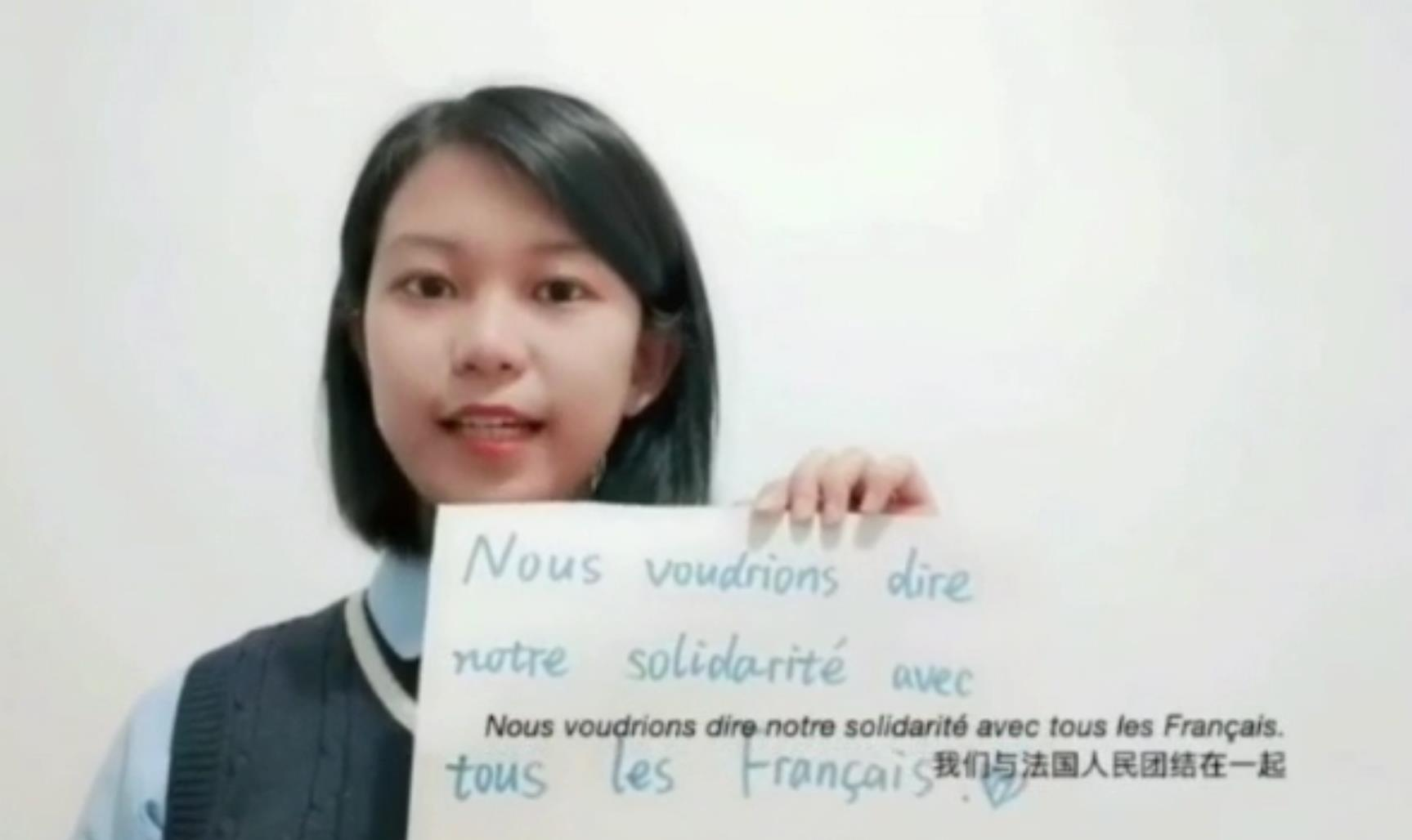 Chinese students share protective masks, courage to defeat COVID-19 with French peers