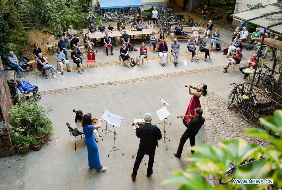 People enjoy backyard concert performed by Staatskapelle Berlin orchestra in Berlin