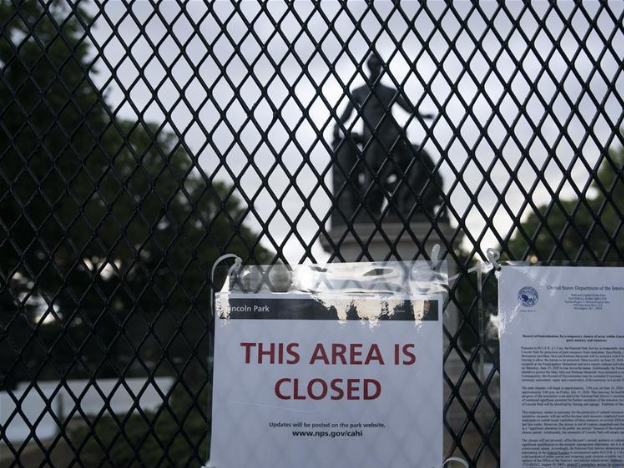 Fense placed around Emancipation Memorial at Lincoln Park in Washington