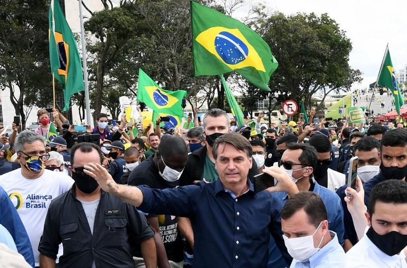 Bolsonaro says he may have had COVID-19 despite negative test