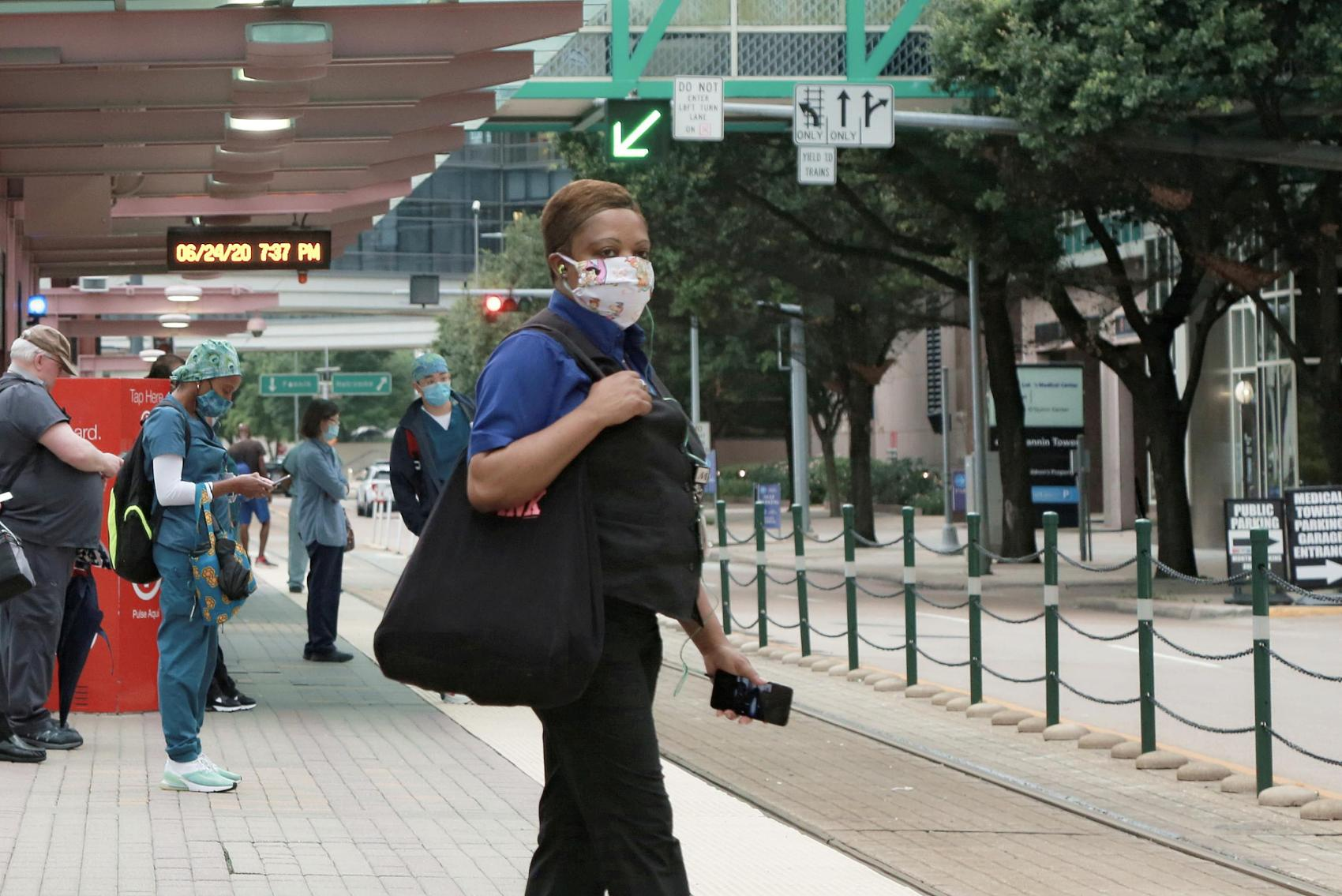 Some US states pause reopening as virus cases near record high