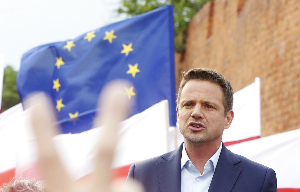 A divided Poland holds presidential vote delayed by pandemic