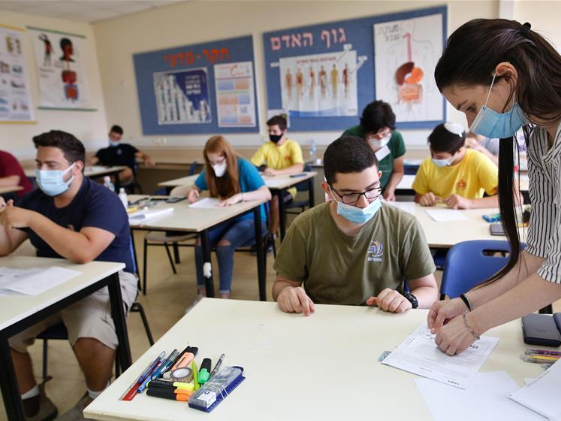 Israeli high school students wearing face masks take part in graduation exam amid COVID-19 pandemic
