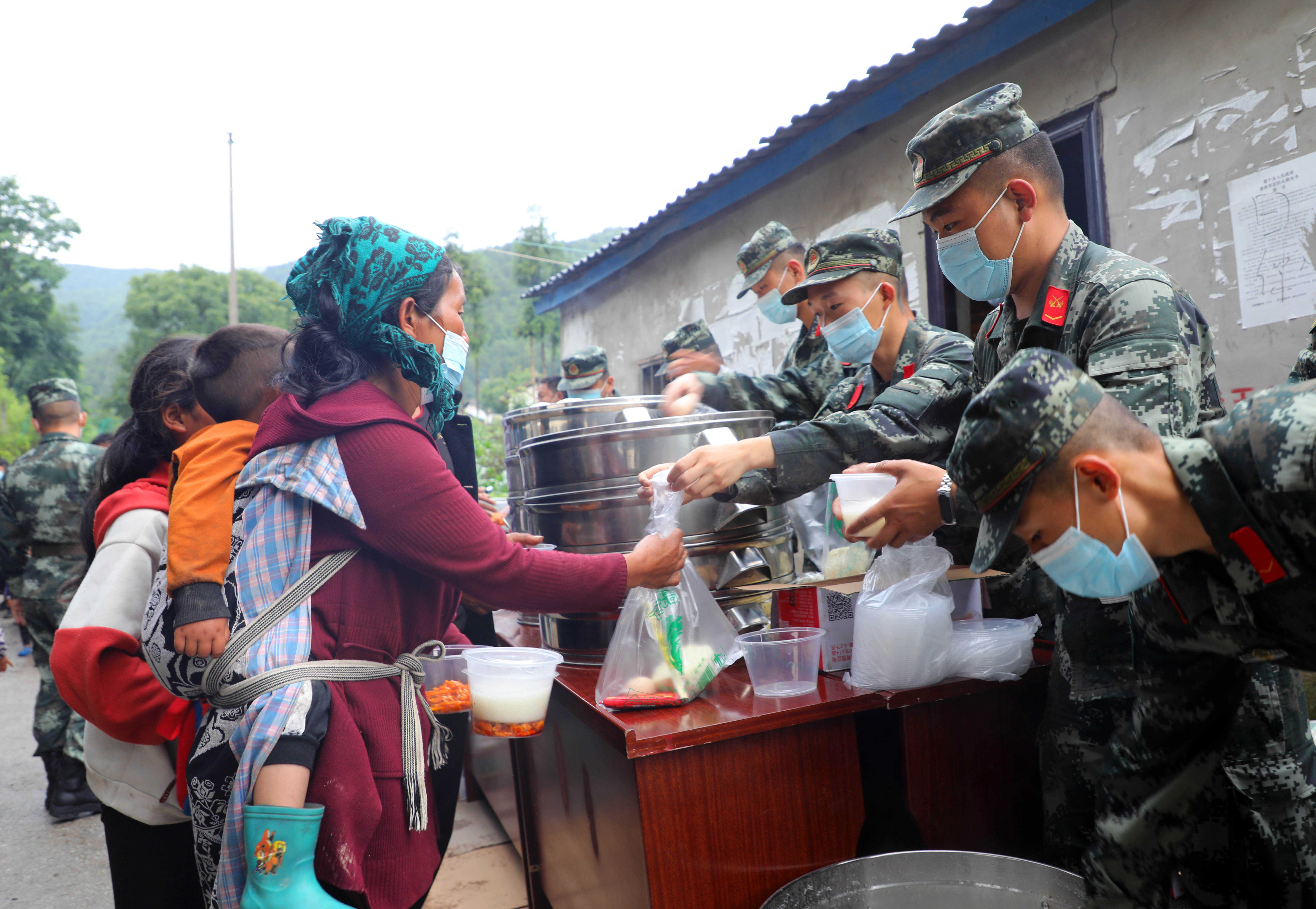 China makes all-out relief efforts as heavy downpours wreak havoc
