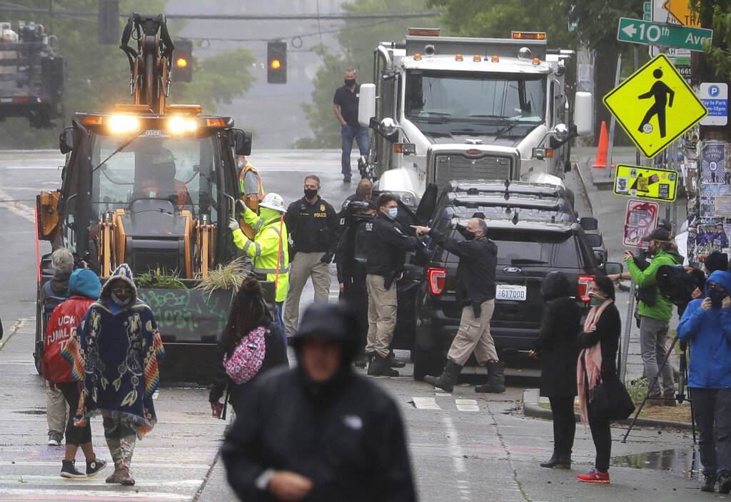 Seattle police act to clear protesters from 'occupied' area