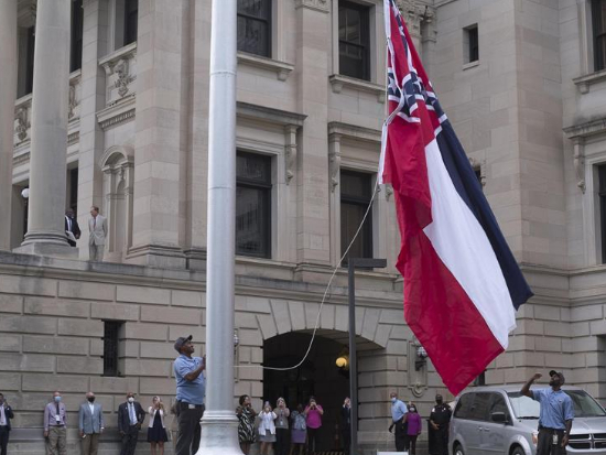 US Mississippi governor signs bill to remove Confederate emblem from state flag