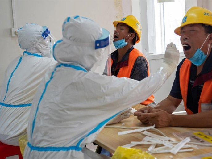 Construction workers receive nucleic acid tests in Daxing District of Beijing