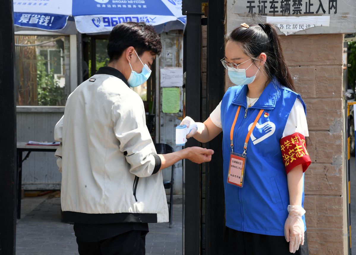 COVID restrictions lowered in Beijing