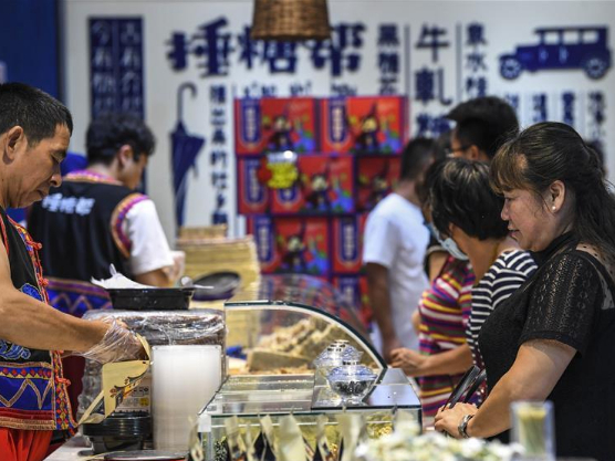 People visit West Street in Yangshuo County, Guangxi