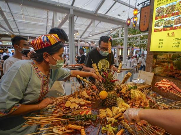 People visit Grand Bazaar Food Street in Urumqi, Xinjiang