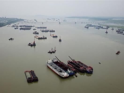 Chinese regions raise flood response levels