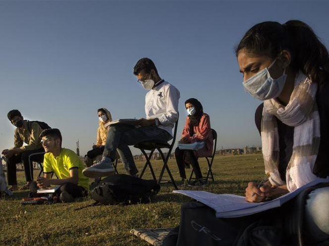 Students attend open-air class in Indian-controlled Kashmir