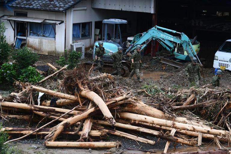 AFP6132367346640765450474819481267467615309-flood-rain-weather-japan-weather-flood-1.jpg