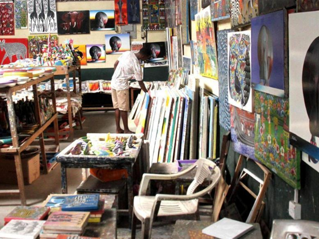 Artists arrange artworks at Tingatinga Arts Cooperative Society in Tanzania