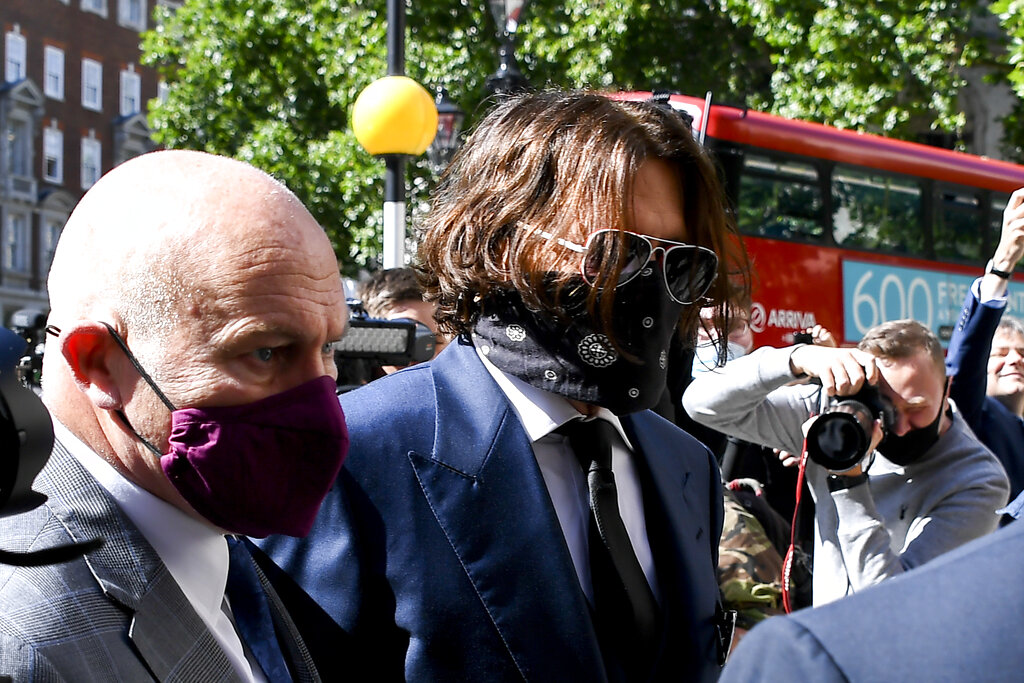 Johnny Depp 'not a wife-beater', libel trial told