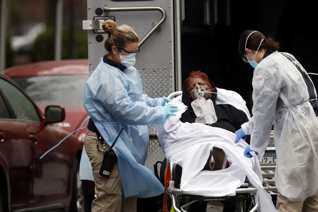 US posts new daily virus case record of 60,209: Johns Hopkins
