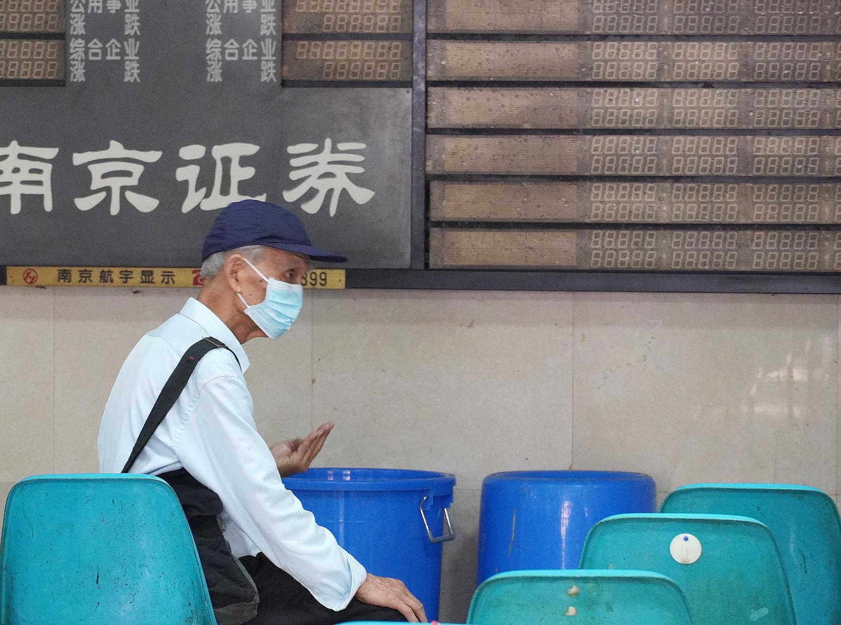 China's key stock index opens flat Thursday