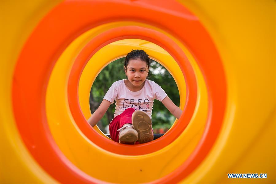 People enjoy leisure time at park in Vientiane, Laos