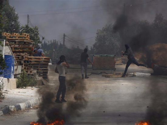 Protesters hurl stones at Israeli soldiers during clashes in village of Kifl Haris