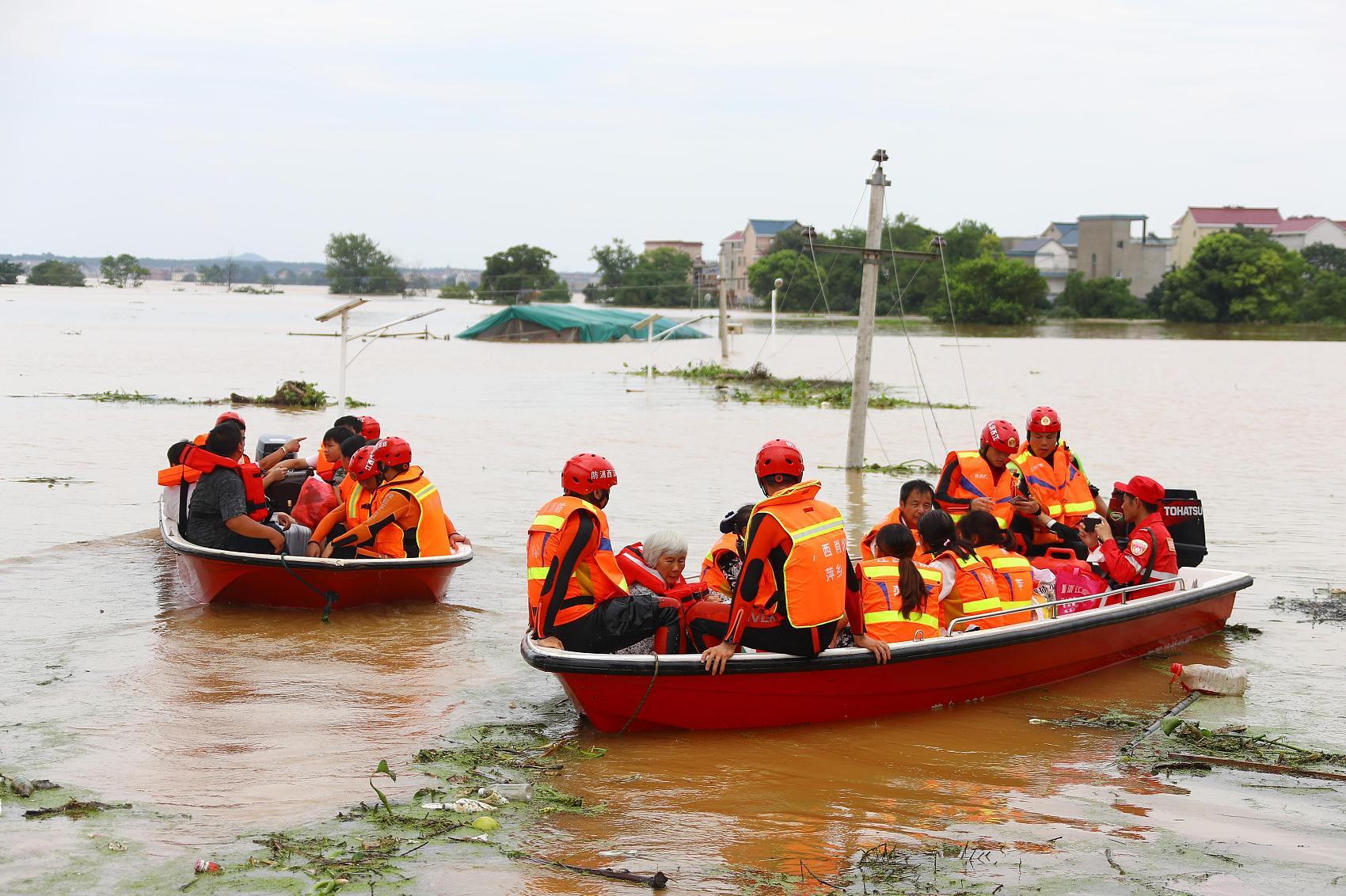 China raises flood response to second-highest level