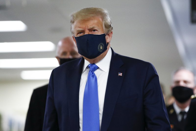 Trump wears mask on camera for first time as he visits military hospital