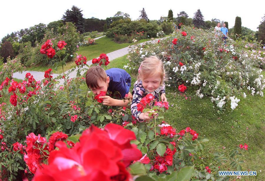 People enjoy flowers at botanical garden in Minsk, Belarus