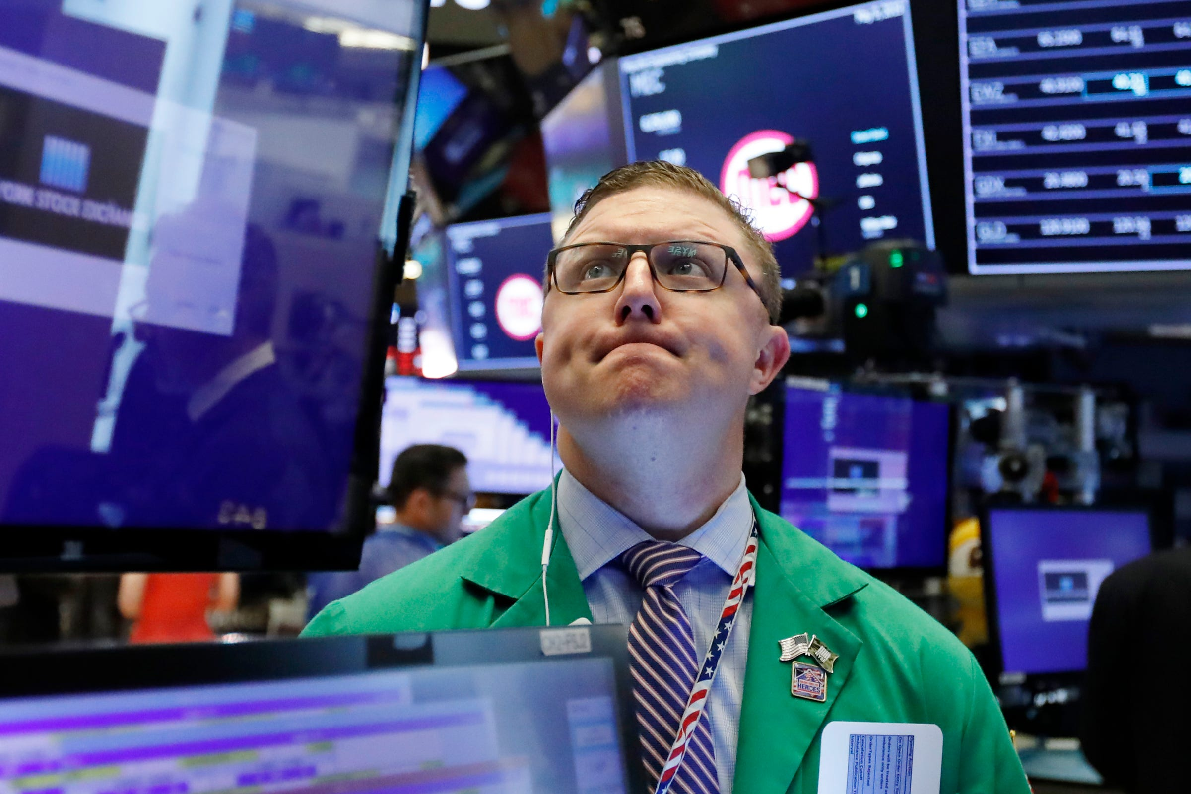 US stocks open lower amid earnings reports