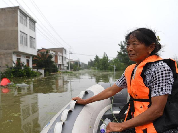 Anhui organizes rescue teams, boats to help villagers get back home