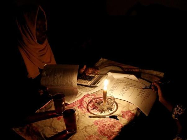 Female student studies for basic school certificate examinations in Khartoum, Sudan
