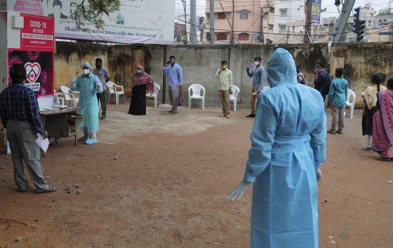 India virus cases surge nearly 32,700, beach state shut anew