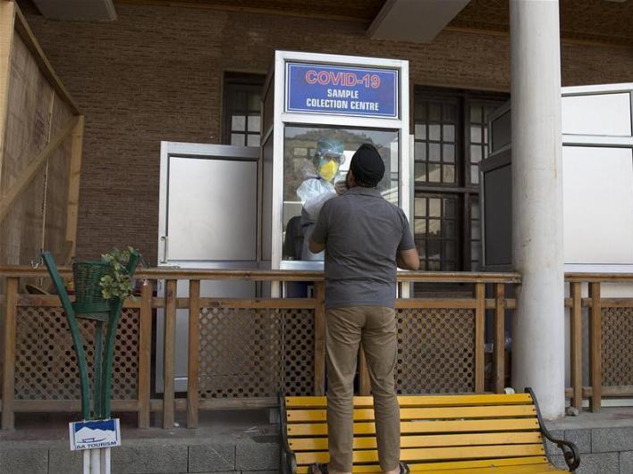 Health workers take nasal swab samples in Srinagar