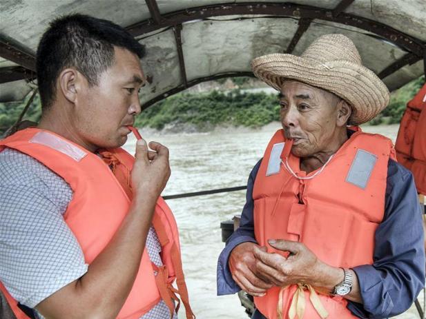 Daily life of ferryman at Miaoshang crossing in Huangjinxia Town, China's Shaanxi